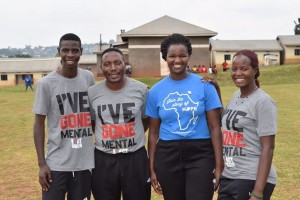 Eddy Ssenkaali (far left) is joined by Fields of Dreams Uganda staff members Jonathan Ssebambulide, Florence Ngamita, and Mercy Ajok to celebrate Eddy becoming a full-time staff member.