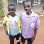 Junior (right) posing for a picture with a fellow FoDU classmate.
